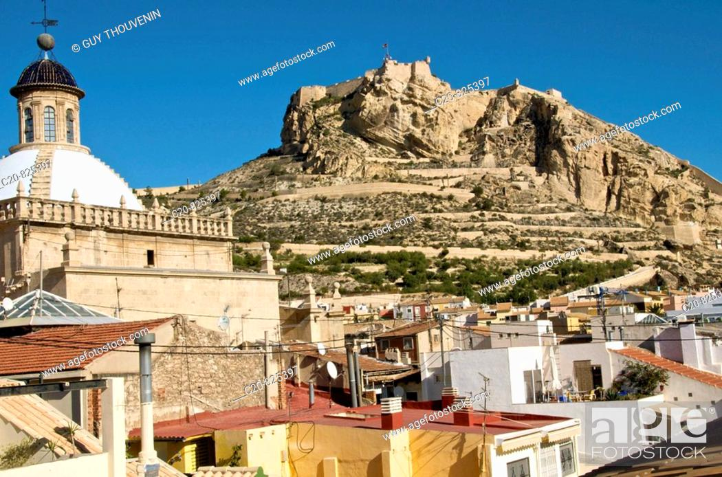 Stock Photo: Co-cathedral of St. Nicholas of Bari on the left and castle of Santa Barbara in background, Alicante. Comunidad Valenciana, Spain.