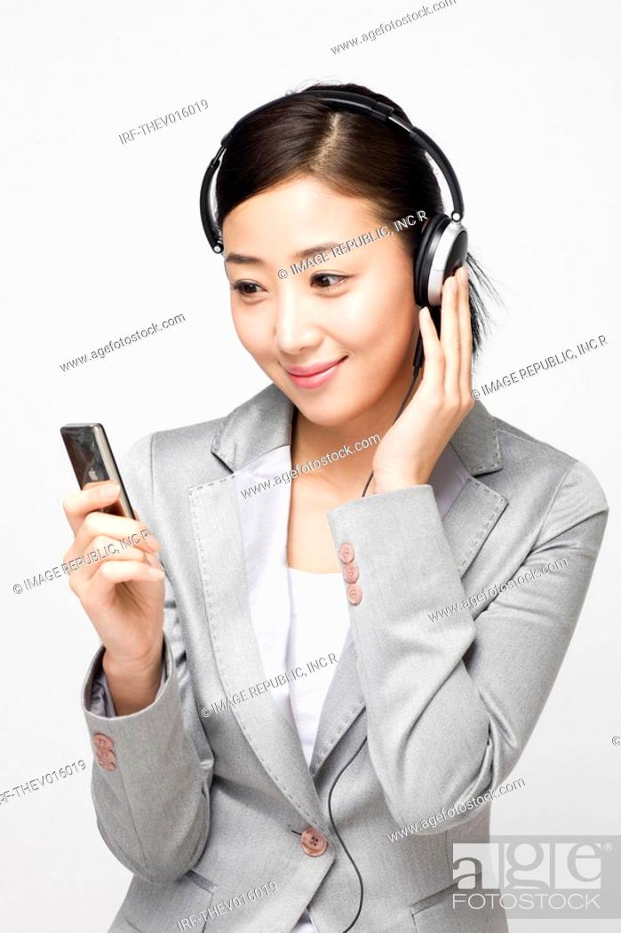 Stock Photo: businesswoman wearing headset.