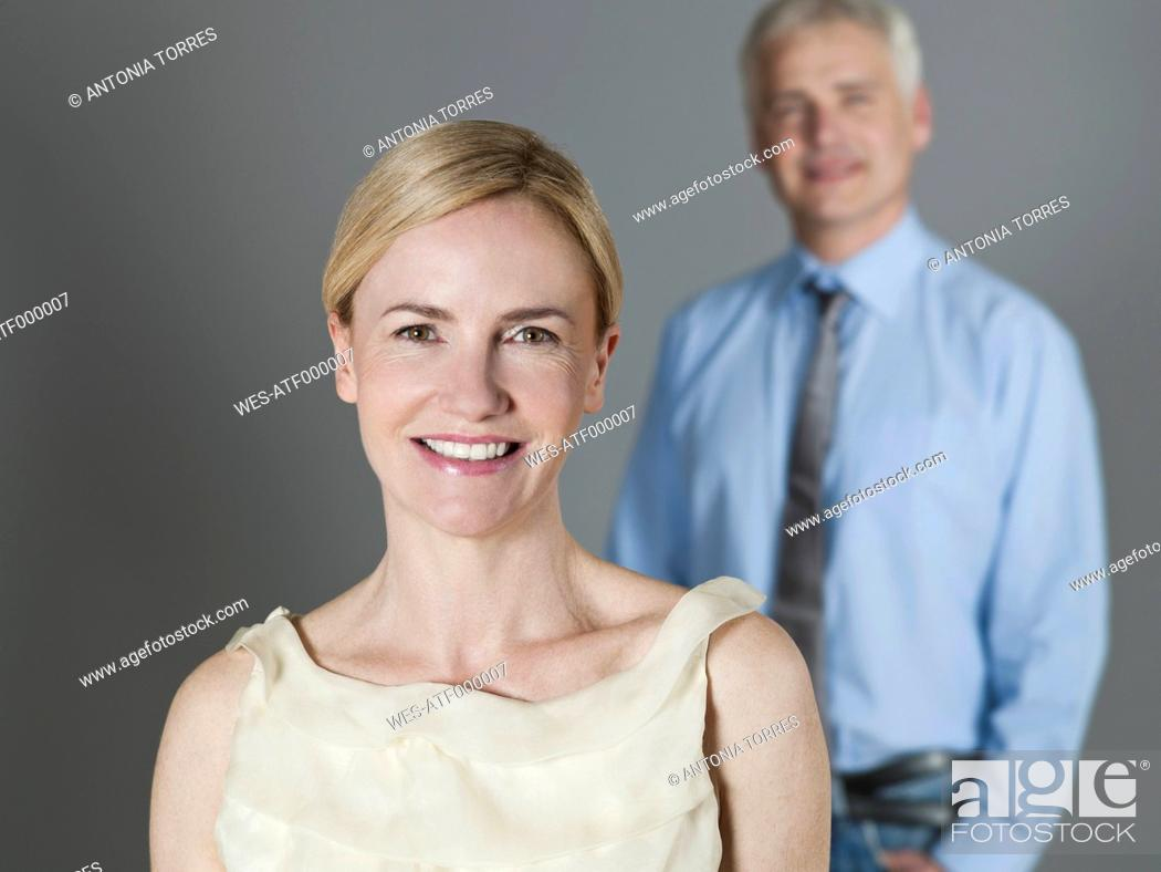 Stock Photo: Mature couple smiling, portrait.