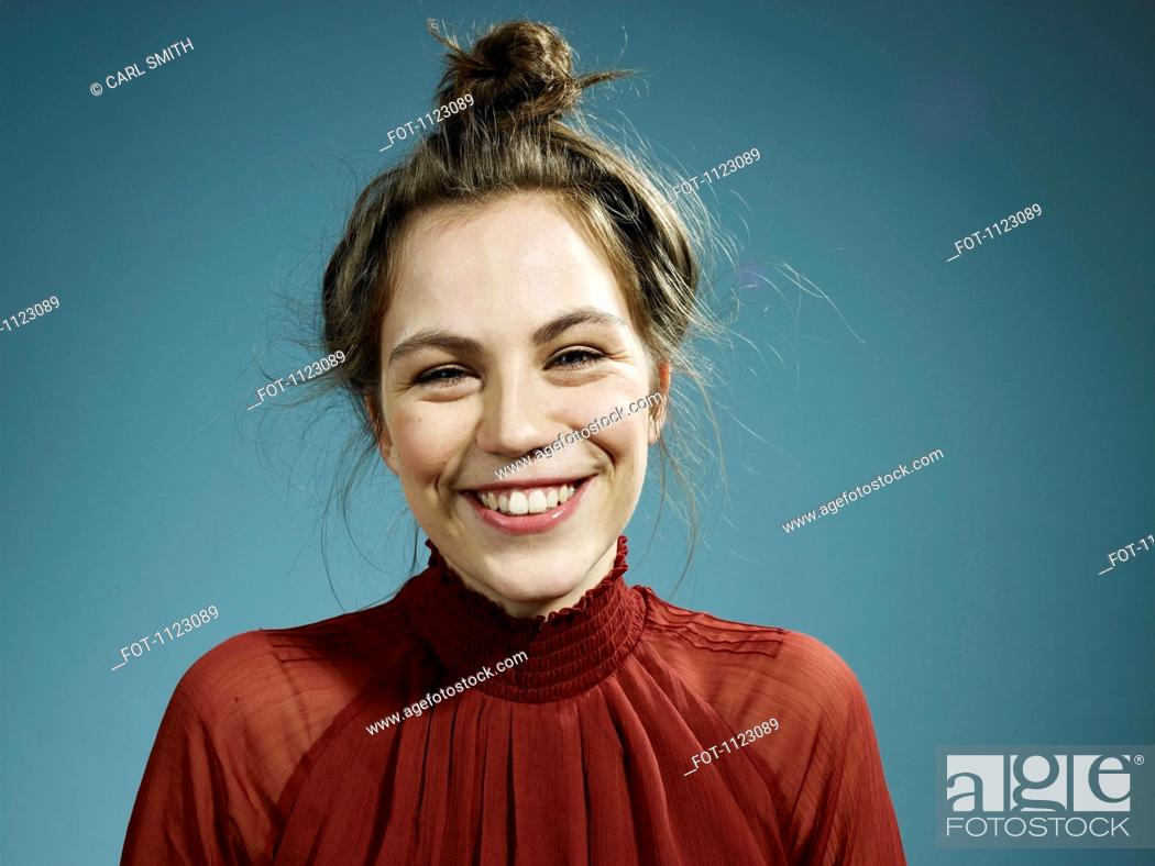 Stock Photo: A happy hip young woman smiling at the camera.