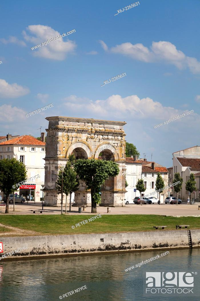 Stock Photo: Arch of Germanicus on the right bank by the River Charente.