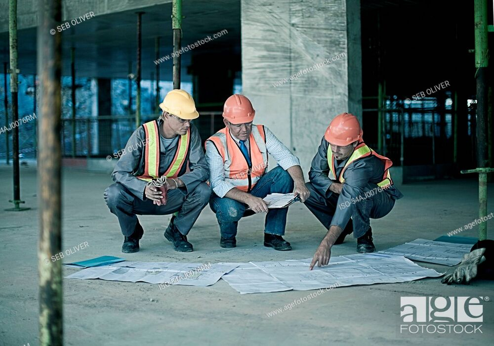 Stock Photo: Workers and businessman on site.