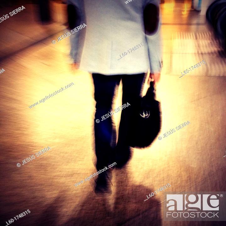 Stock Photo: Man walking in RENFE station, Madrid, Spain.