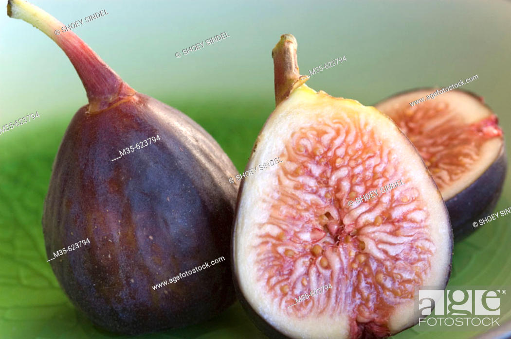 Stock Photo: Fresh figs, whole and sliced.