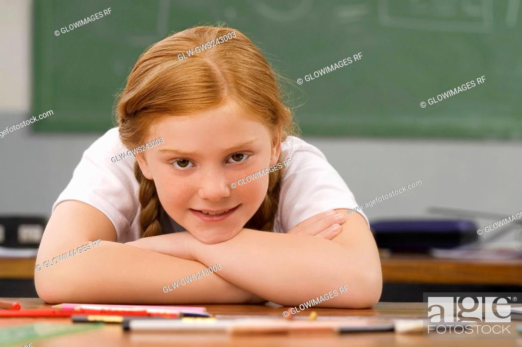 Stock Photo: Portrait of a girl leaning on her elbows and smiling.