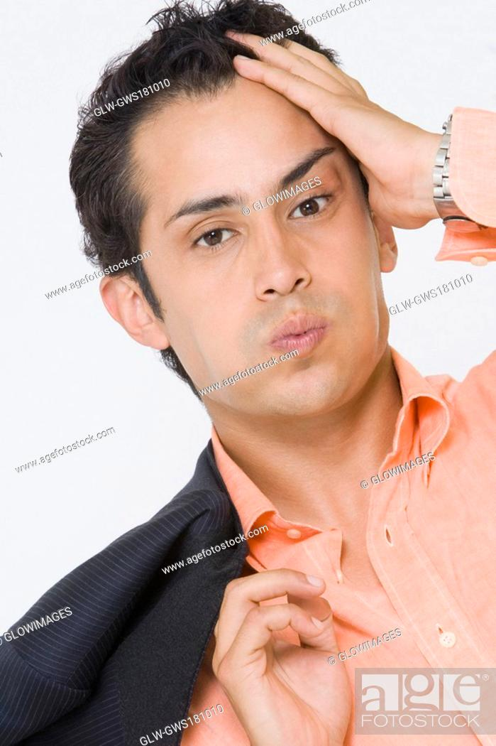 Stock Photo: Portrait of a businessman suffering from a headache.