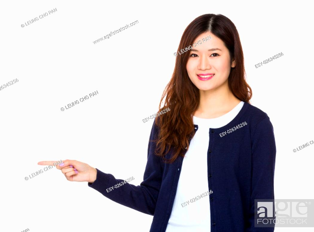 Stock Photo: Asian woman with finger point aside.