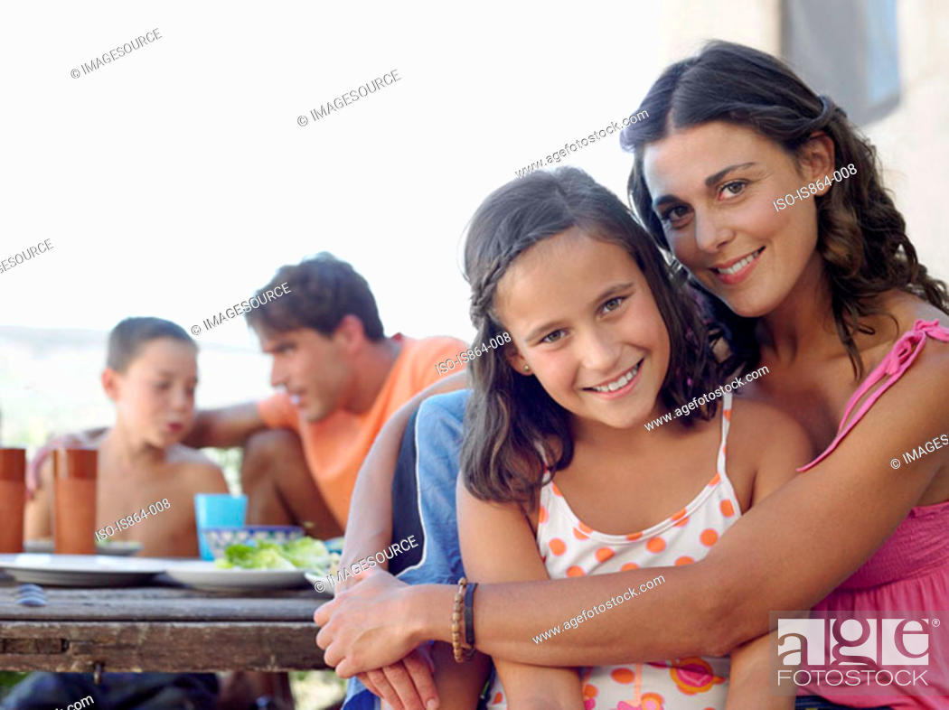 Stock Photo: Mother and daughter at meal outdoors.