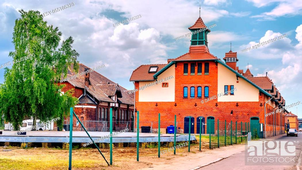 Stock Photo: Old ruined port stables and renovated slaughterhouse buildings from early 1900s in Szczecin harbour. Customs wharf and Stettin Boulevards, Poland.
