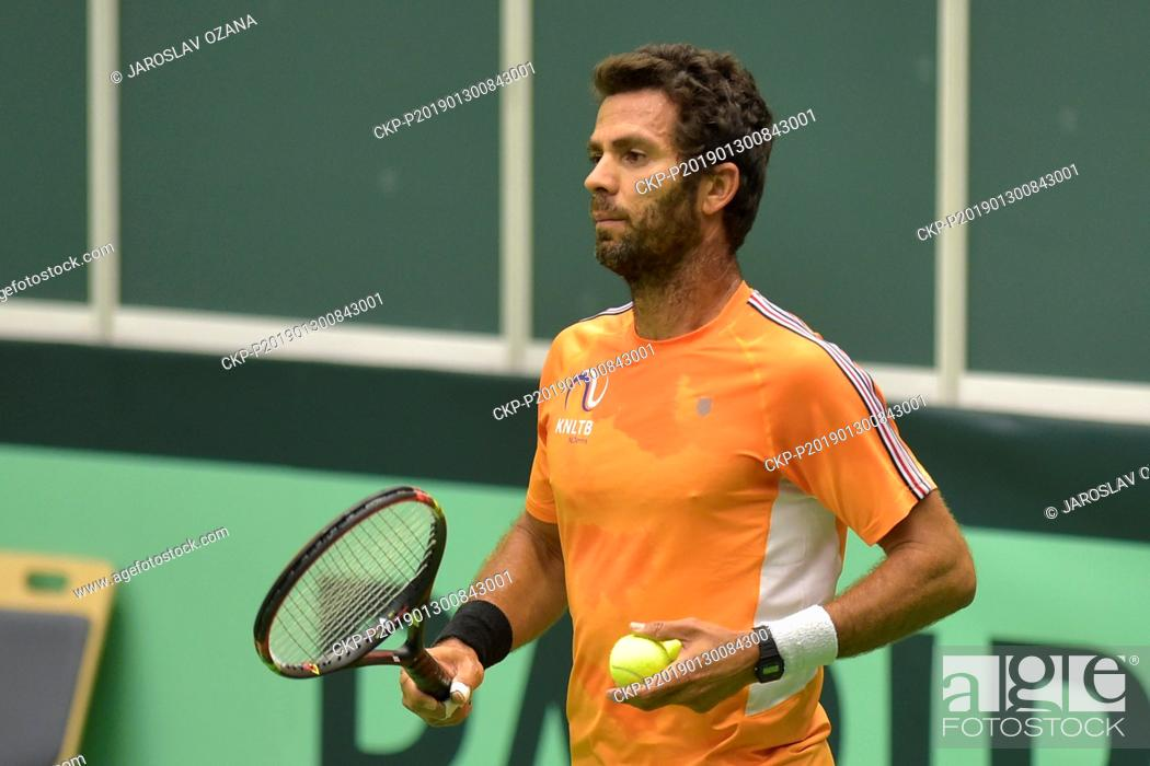 Stock Photo: Netherland's Jean-Julien Rojer plays a ball during a training session in Ostrava, Czech Republic, January 30, 2019. In the new Davis Cup format.