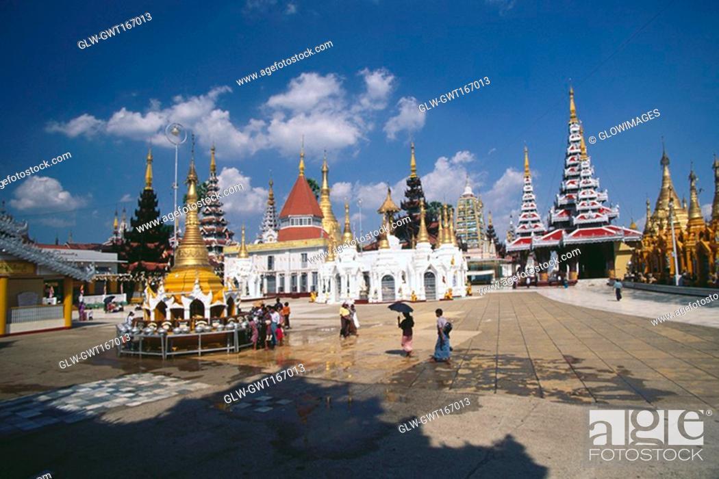 Stock Photo: Pilgrims in front of a pagoda, Shwedagon Pagoda, Yangon, Myanmar.