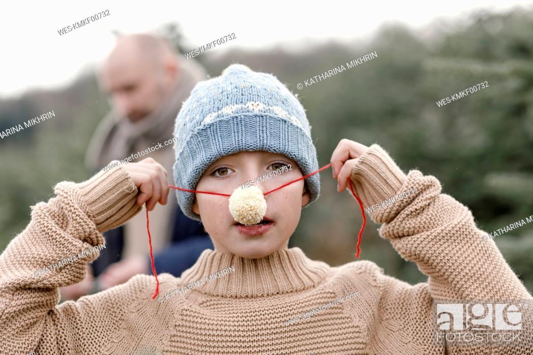 Photo de stock: Portrait of a boy putting on woolen nose.