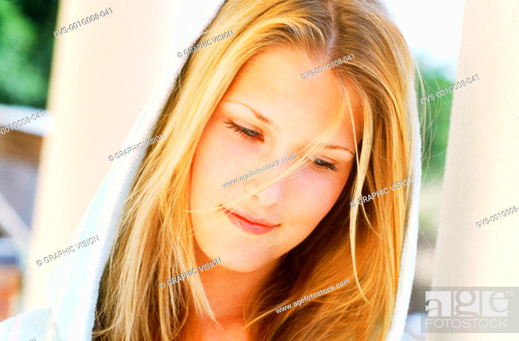 Stock Photo: Portrait of young woman looking down.