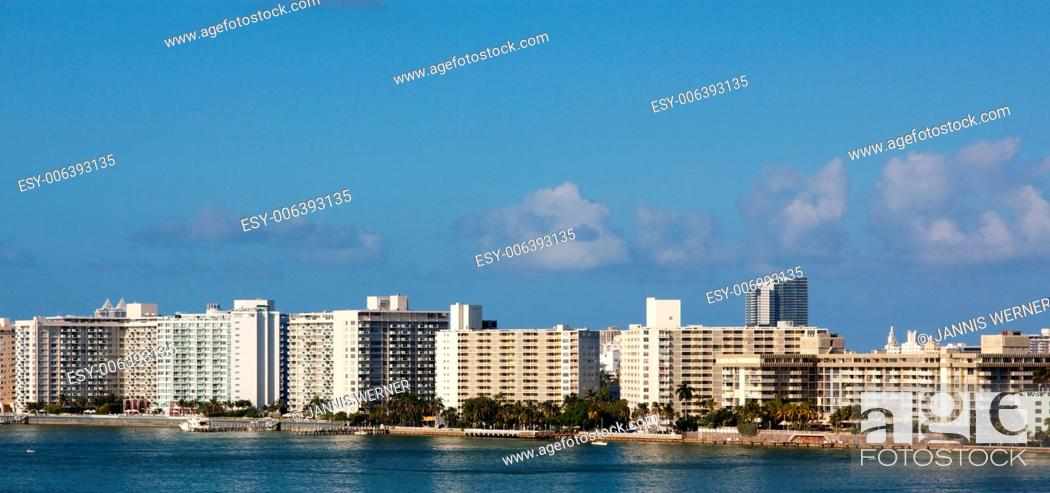 Stock Photo: Row of nondescript apartment buildings by the water in Miami, FL, USA.