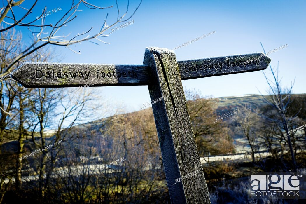 Stock Photo: Wooden signpost of a trail (Dales Way footpath) on a cold morning with frost.. Buckden, Skipton, North Yorkshire, England, UK.