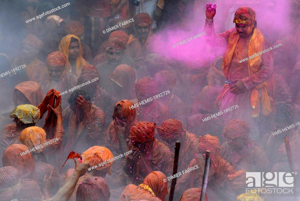 Stock Photo: India, Uttar Pradesh State, in Barsana temple, musicians receive coloured powder during the Holi festival celebrations.