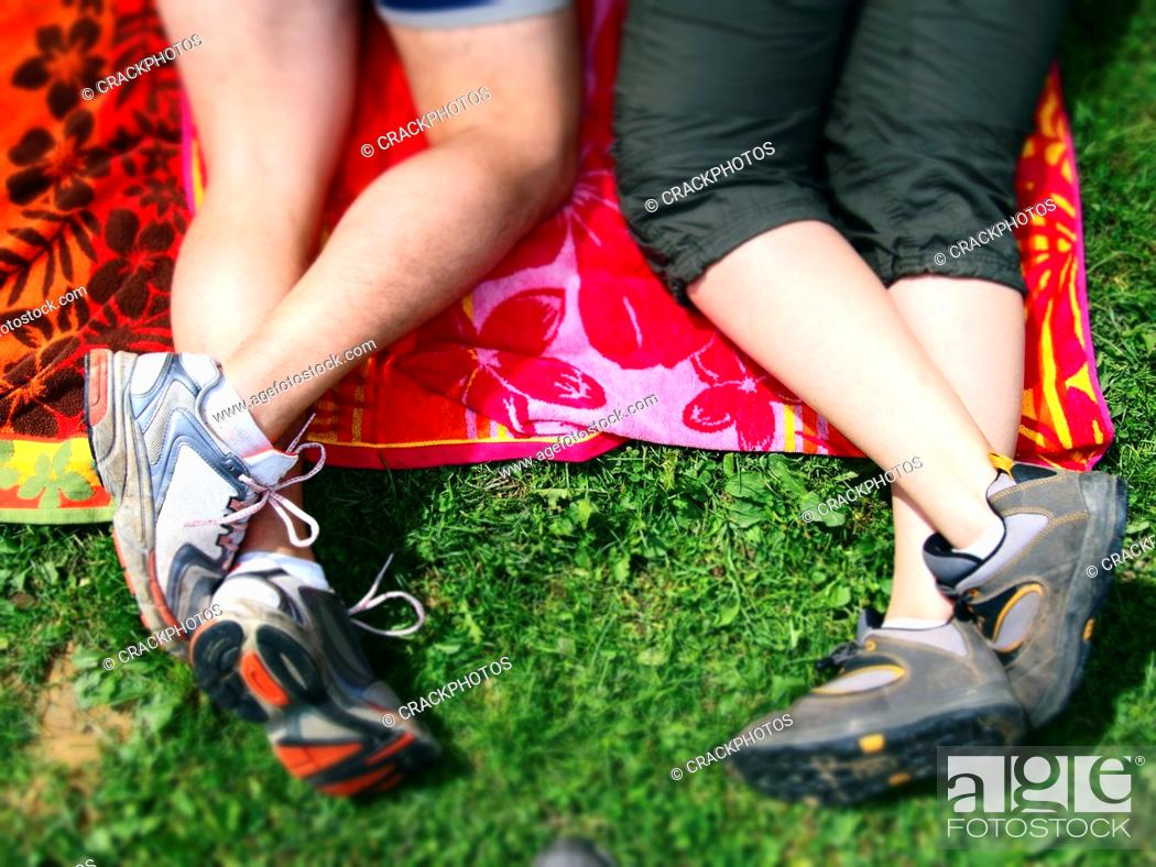 Stock Photo: Couple lying on the grass. Spain.