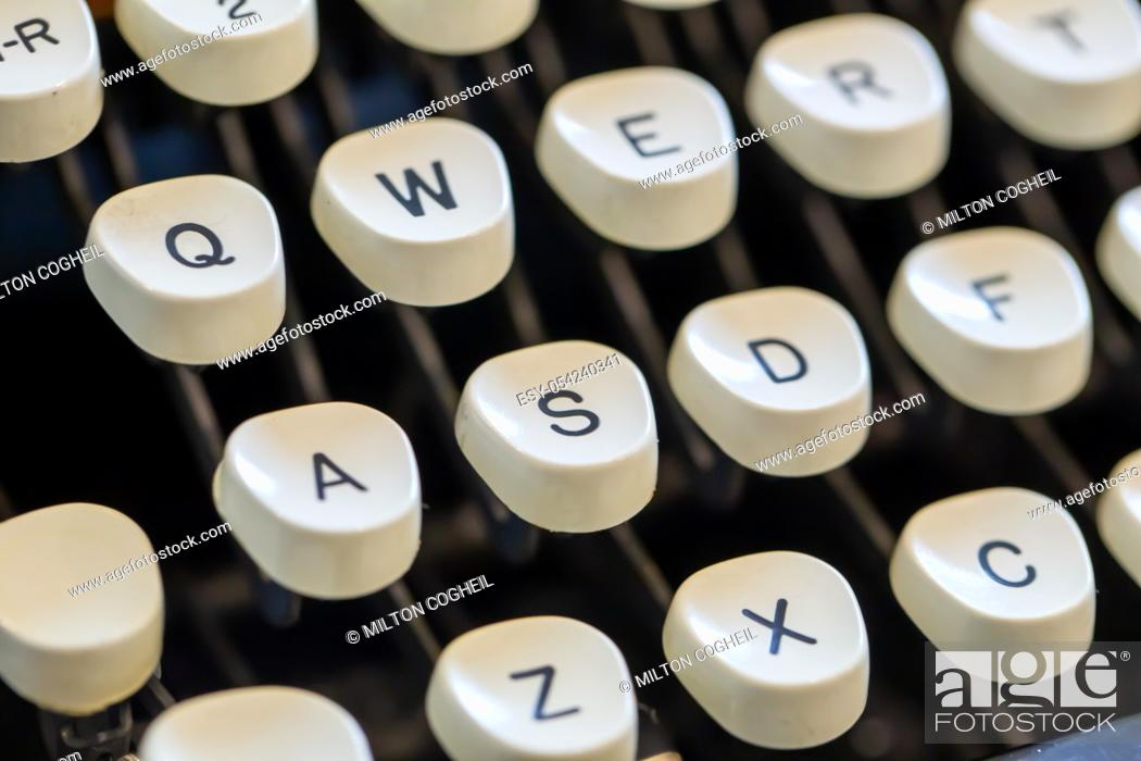 Stock Photo: Close up of letters on an old fashioned typewriter keyboard.