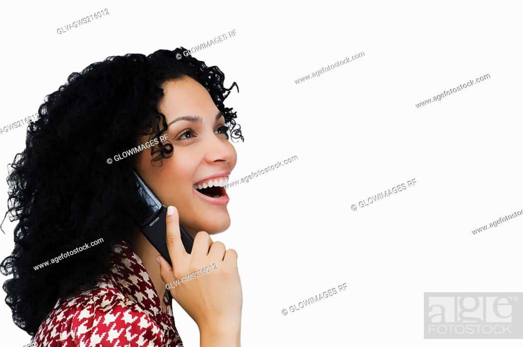 Stock Photo: Side profile of a businesswoman using a mobile phone.