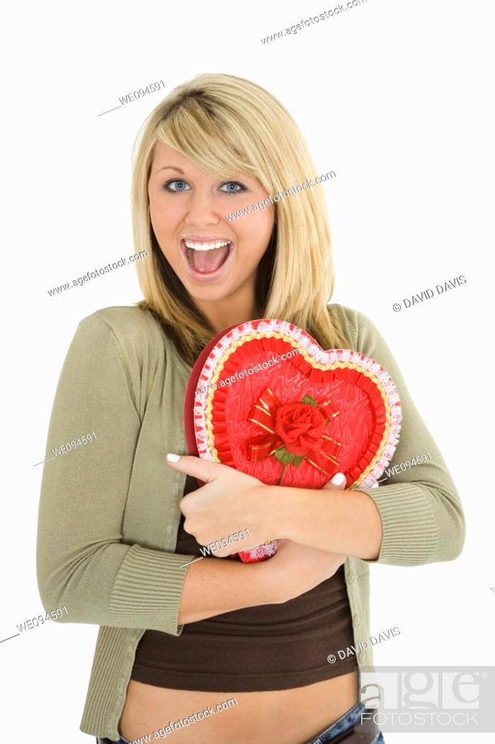 Stock Photo: Young Caucasian woman very excited after recieving a special gift.