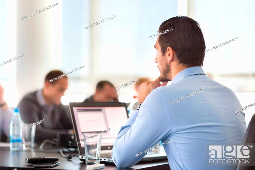 Stock Photo: Corporate business meeting in office. Business executive giving instructions to his colleagues. Explaining business plans to employees.