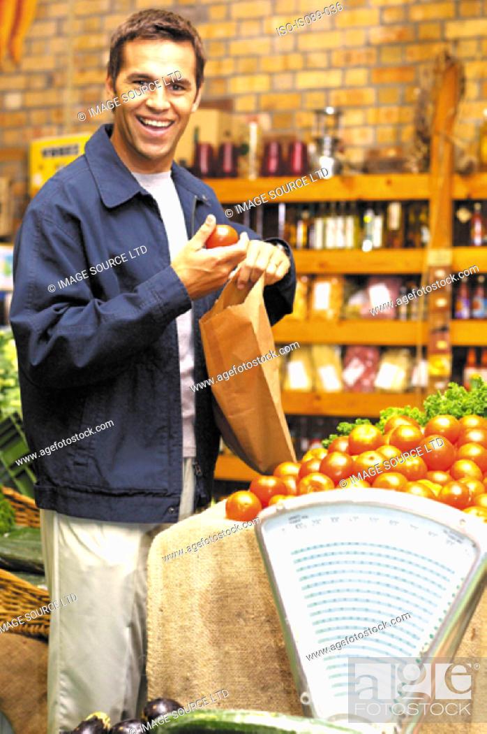 Stock Photo: Man buying food.
