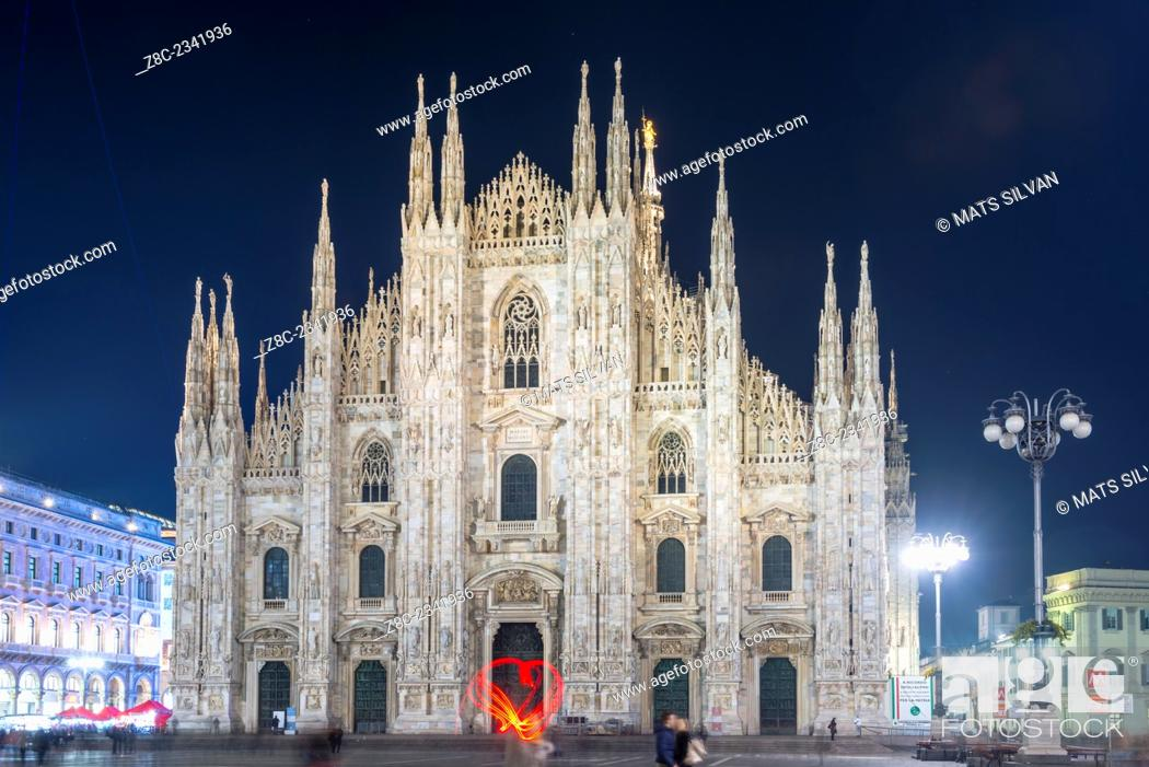Stock Photo: Duomo di Milano and a woman light paint a heat in Lombardy, Italy.