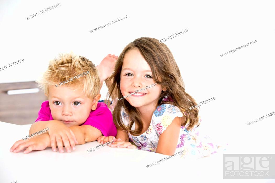 Stock Photo: Germany, Brother and sister smiling, close up.