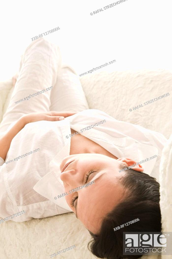 Stock Photo: woman relaxing on sofa.