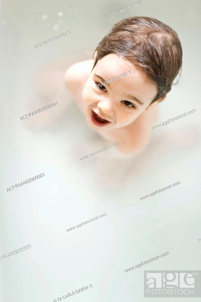Stock Photo: Toddler boy taking a bath, portrait.