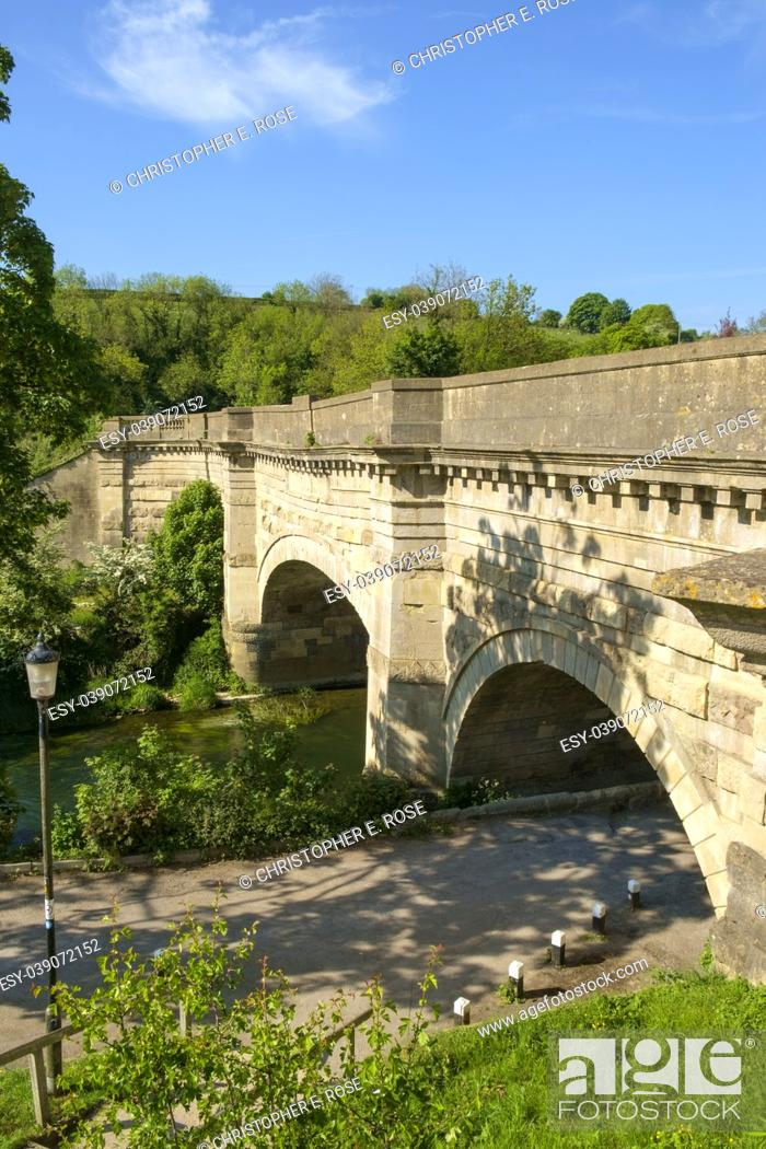 Stock Photo: Historic Avoncliff Aqueduct carries the Kennet and Avon Canal over the River Avon and the Bath to Westbury railway line, at Avoncliff in Wiltshire, England.
