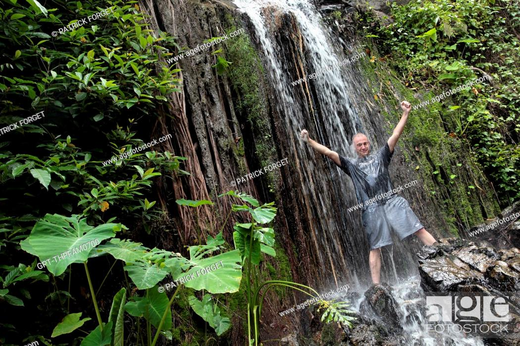 Stock Photo: COOLING OFF UNDER A WATERFALL, TREKKING IN THE JUNGLE, NATURE RESERVE IN THE REGION OF BANG SAPHAN, THAILAND, ASIA.