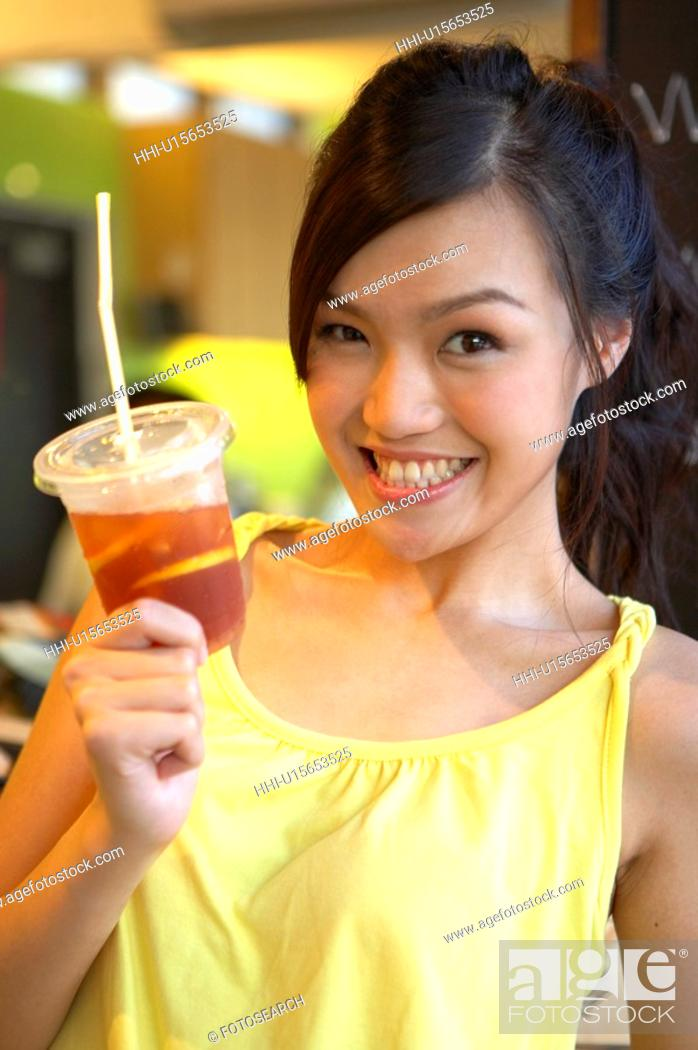 Stock Photo: Young Lady Holding Cold Drink.