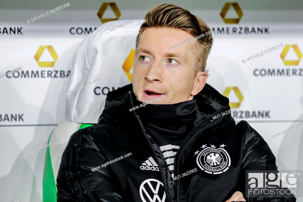 Imagen: Wolfsburg, Germany, March 20, 2019: Germany national team footballer Marco Reus sitting on the bench during the international soccer game Germany vs Serbia at.
