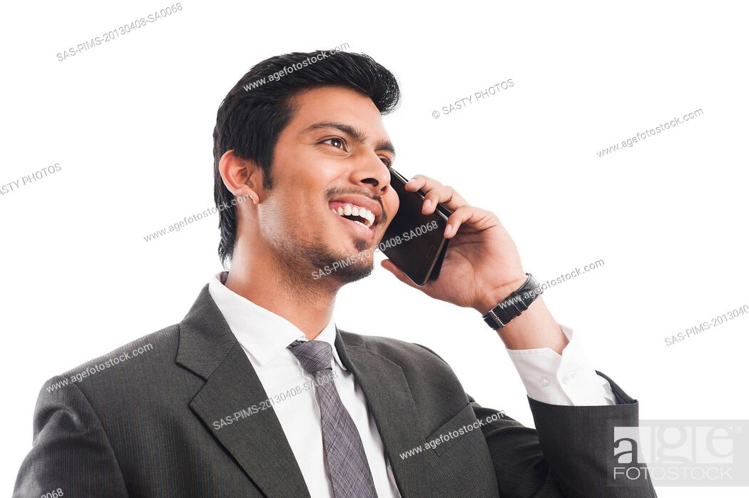 Stock Photo: Businessman talking on a mobile phone.