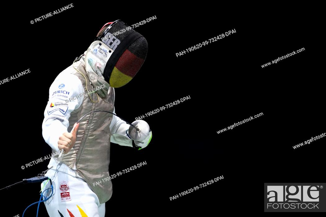 Stock Photo: 20 June 2019, North Rhine-Westphalia, Duesseldorf: Fencing: European Championship, Florett Team, Men, Final, Germany - France: Germany's Andre Sanita bends his.