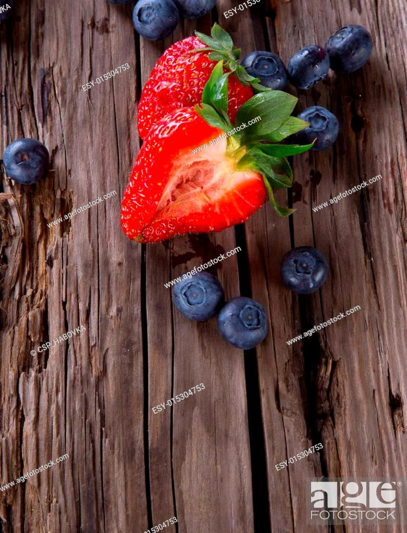Stock Photo: Fresh fruits on wood.