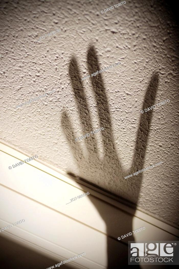 Stock Photo: Shadow of hand on wall.