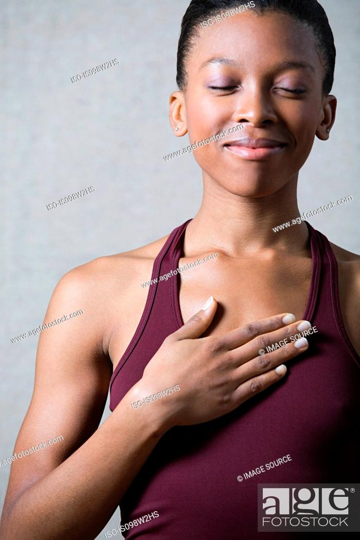 Stock Photo: Women breathing deeply, touching chest.