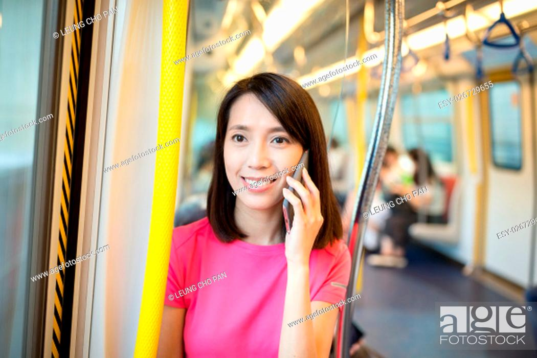 Stock Photo: Woman talk to phone inside train compartment.