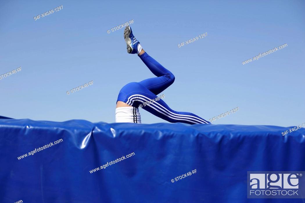 Stock Photo: Woman falling on safety mat.