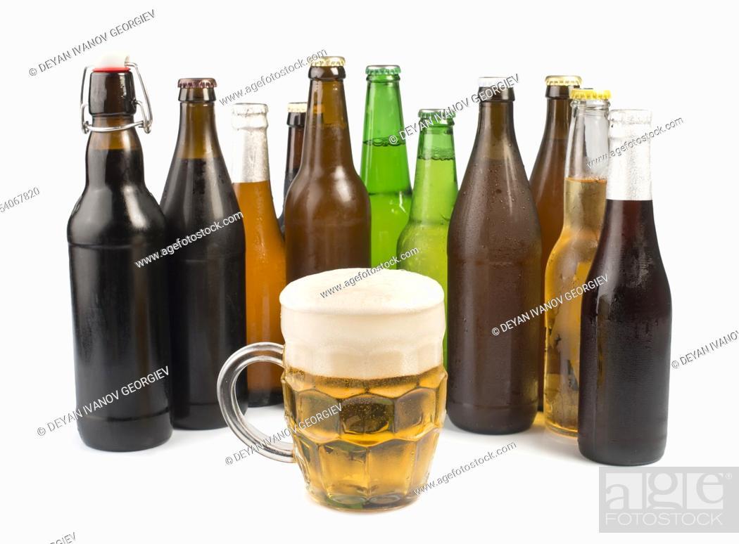 Stock Photo: Bottles of beer and beer mug. White isolated studio shot.