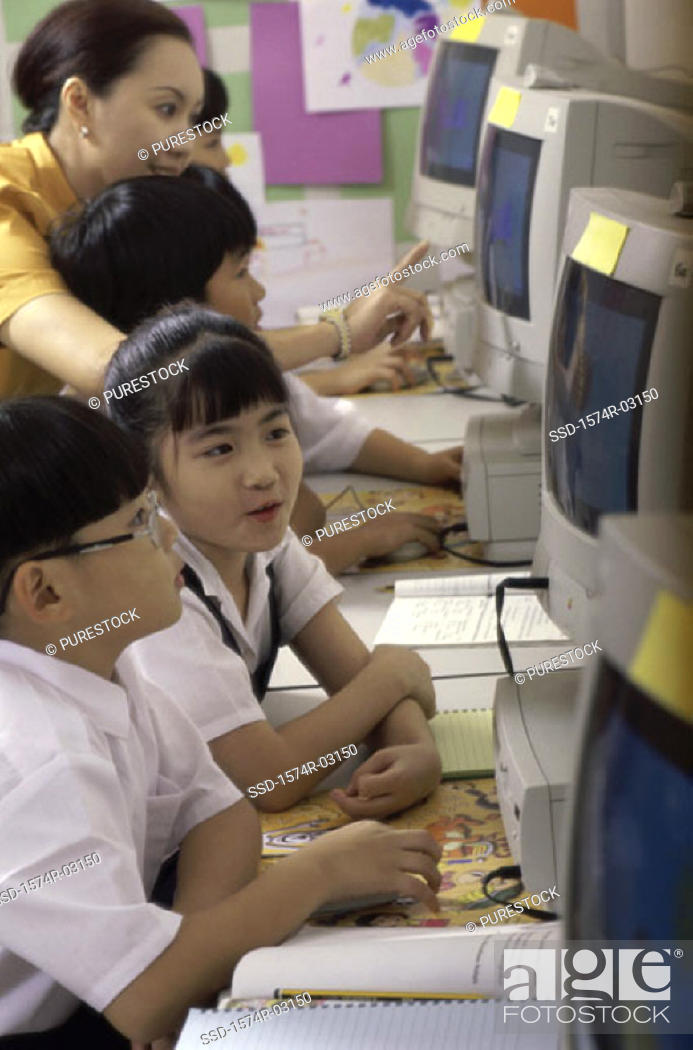 Stock Photo: Children sitting in a computer lab.