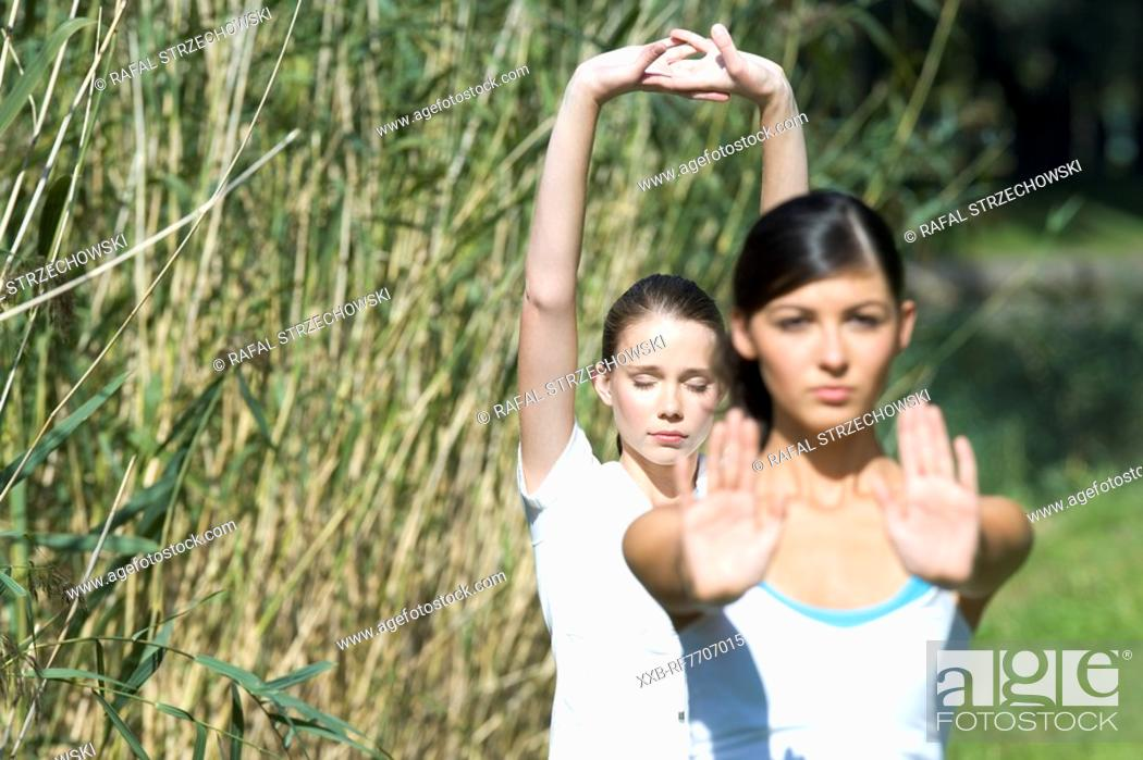 Stock Photo: Young women exercising in park.
