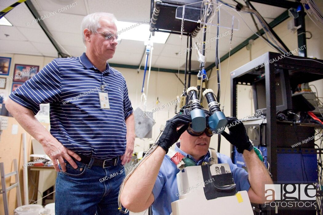 Stock Photo: NASA astronaut Steve Bowen, STS-133 mission specialist, uses virtual reality hardware in the Space Vehicle Mock-up Facility at NASA's Johnson Space Center to.