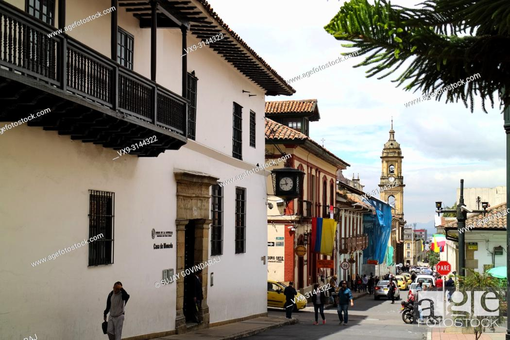 Imagen: Bogota, Colombia - January 27, 2017: Looking down Calle, or translated into English, Street, 11 in La Candelaria. To the left of the image is the entrance to.