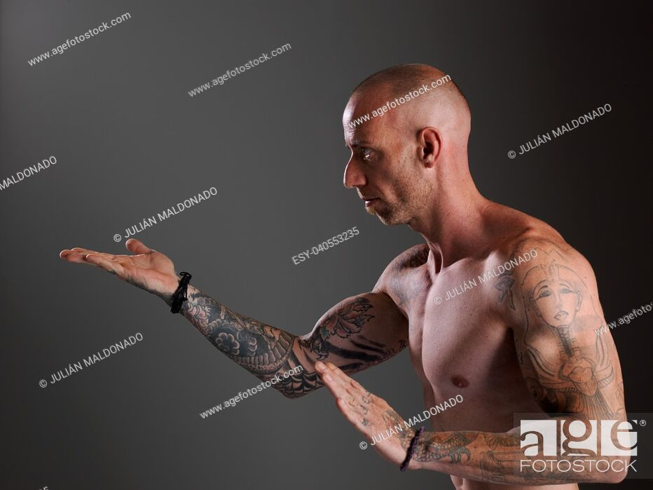 Stock Photo: Young bodybuilder showing his physiognomy.