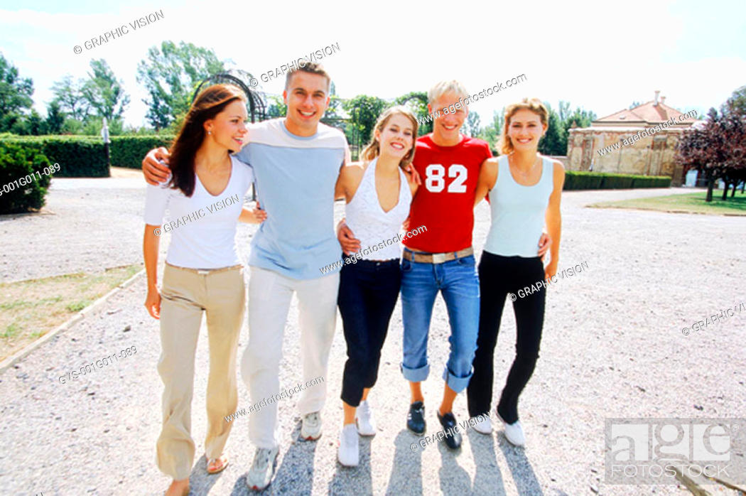Stock Photo: Portrait of a man walking arm in arm with four women.