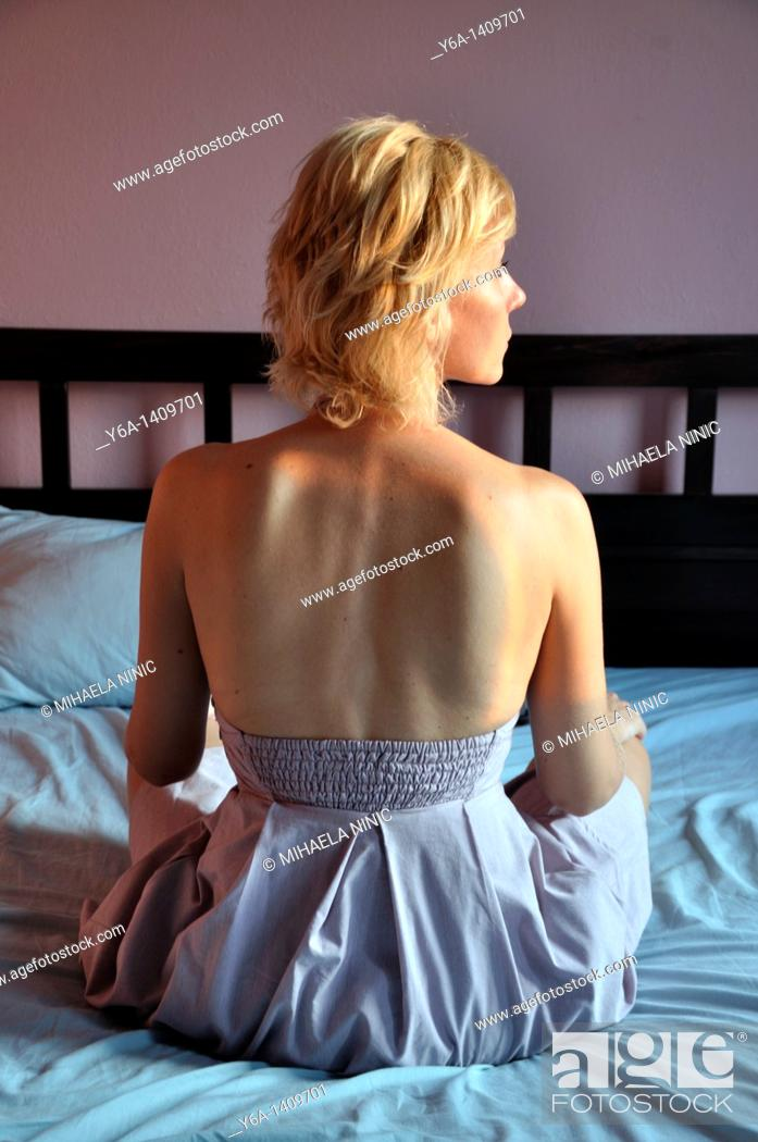 Stock Photo: Attractive young woman on bed.