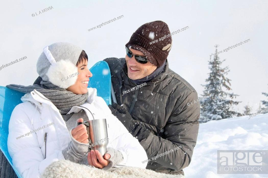 Stock Photo: Young couple in ski wear resting.